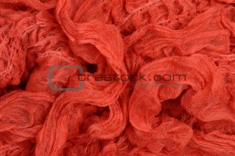 close up red knitted scarf background