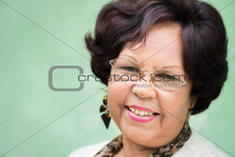 Portrait of happy elderly black lady with eyeglasses smiling