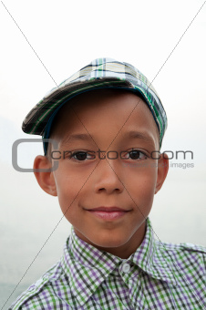boy with brown eyes in cap
