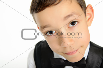 school boy in black suit isolated on white