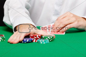 Man with cards on a gambling table