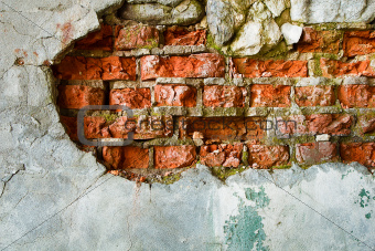 The destruction of a brick wall