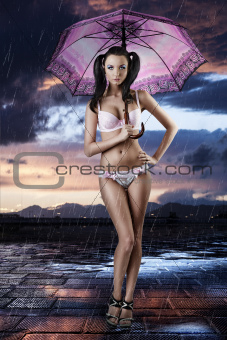 sexy brunette in full lenght with open umbrella
