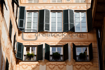 Bright Sunlit Painted House Facade in Genoa, Italy