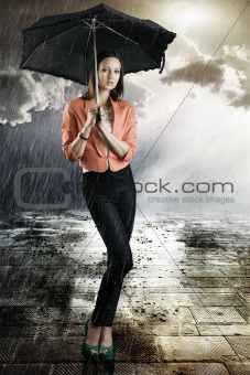 beautiful woman with umbrella, takes tatch with both hands