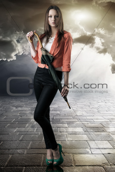 beautiful woman with closed umbrella
