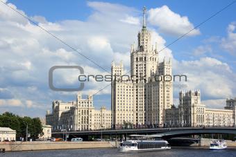 Stalin skyscraper against the cloudy sky.