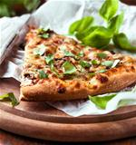 Mushroom pizza topped with basil