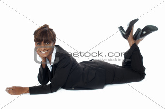 Corporate woman lying on floor, smiling