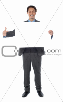 Business professional pointing towards an empty billboard