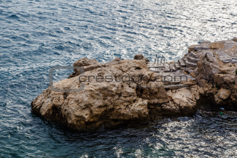 Rock and the Stairs Leading to the Sea in Rovinj, Croatia