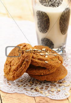 oat cookies biscuits and a glass of milk