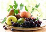 various autumn fruits (pears, apples, peaches and grapes)