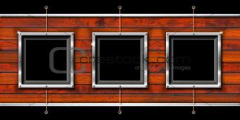 Three Metal Frames on a Grunge Wall