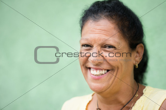 Portrait of happy old hispanic woman smiling at camera