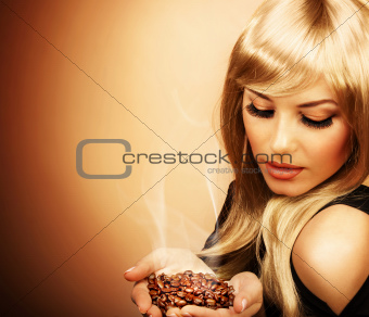 Beautiful woman holding coffee bean