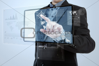 Businessman pushing a button on digital vurtual screen