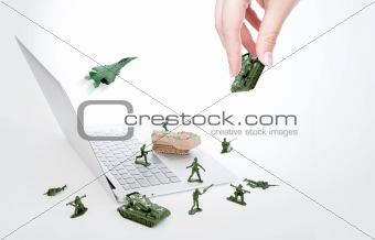 Computer security concept :  soldiers,tank,plane guard laptop