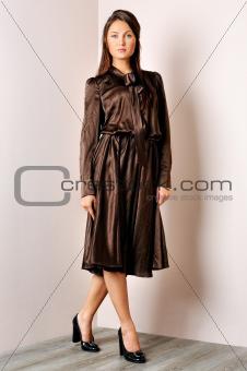 Beautiful woman in brown dress.