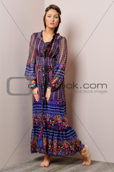 Beautiful barefoot  woman in long blue dress.