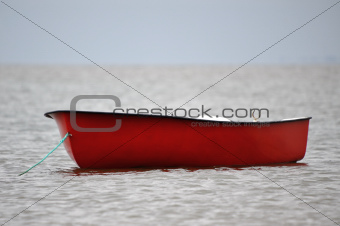 Lonely red boat