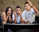 Shocked Hispanic Family Watching TV