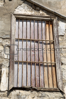 Old locked window with lattice in vintage wall