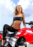 young blonde on a motorcycle
