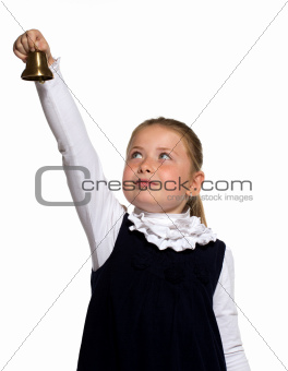Young school girl ringing a golden bell on an outstretched arm o