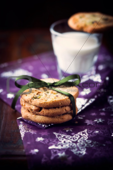 Pistachio cookies and a glass of milk for christmas