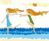 girls running on a beach