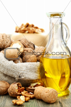 Walnut oil  and nuts in a bag.