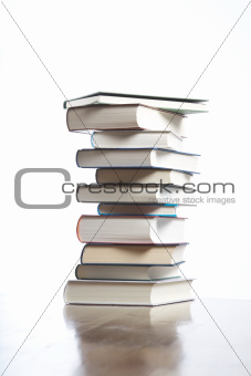 books piled on table