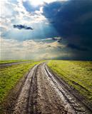dirty road under dramatic sky