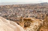Ancient tuff stone caves landscape and Goreme city view Turkey
