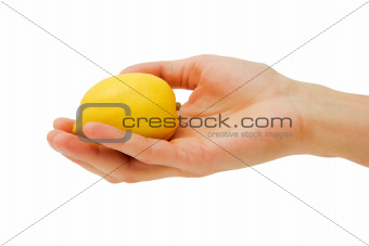 man's hand holding a lemon