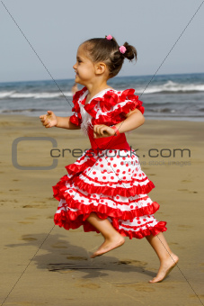 Happy child running on beach