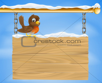 Christmas robin on wooden sign