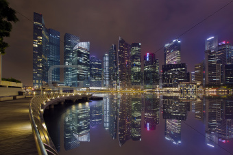 Singapore City Skyline Along Marina Bay Boardwalk at Night