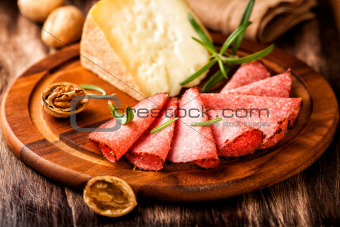 Still life of salami and pecorino cheese