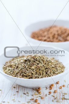 Dried rosemary and coriander seeds