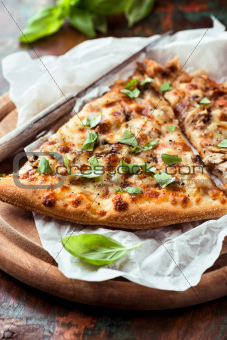 Mushroom pizza topped with basil leaves