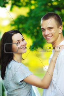 young couple in summer park