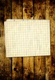 Sheet paper on wooden planks