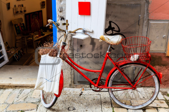 Old Red Bicycle at the Shop Door in Rovinj, Croatia