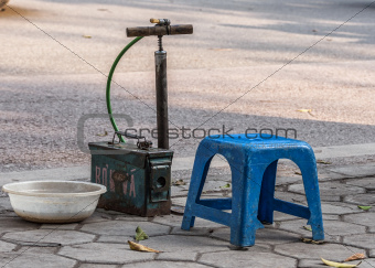 Vietnam Hanoi - March 2012: Simple Bike tire repair stand along