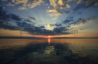 Sunset on the lake with clouds