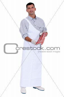 butcher with piece of meat
