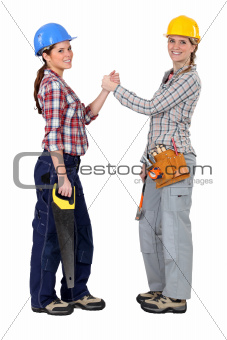 Female construction workers forming a pact