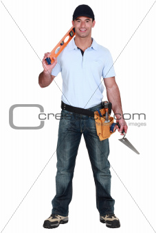 portrait of handsome carpenter carrying ruler